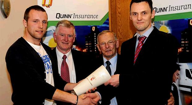 Ambrose Rogers is presented with the GAA Ulster Writers' monthly merit award by Seamus Walsh, Down County Chairman, Matt Fitzpatrick, and Colm Courtney from Quinn Insurance