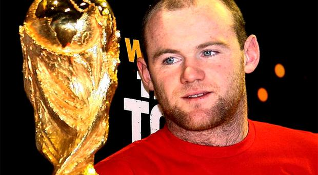 Wayne Rooney gets an early glimpse of the World Cup at the start of the trophy's tour of the UK, in London yesterday