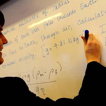 Teachers should not be banned from joining organisations which promote racism, a report suggested