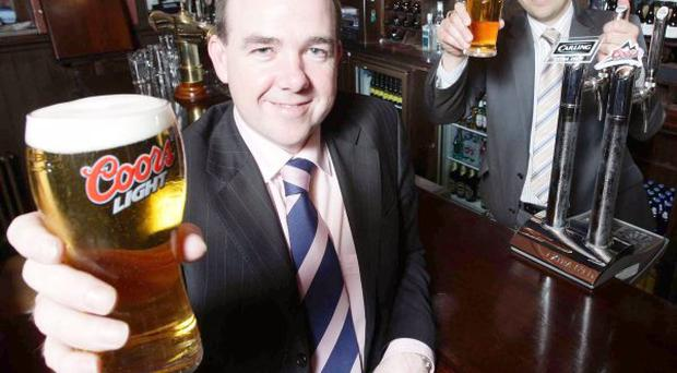 Niall McMullan Head of Sales (NI) and Niall Phelan Country Manager for Molson Coors raise a glass as it is announced that the company is setting up its own direct sales and marketing operations in Northern Ireland
