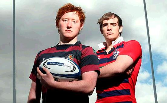 Rival captains Conor Spence (BRA) and George Dennison (Ballymena Academy) square up