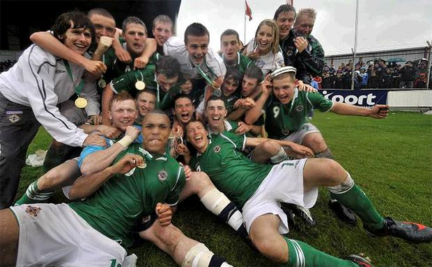 Northern Ireland celebrate on the Coleraine Showgrounds pitch after their triumph in the Milk Cup Elite final last July