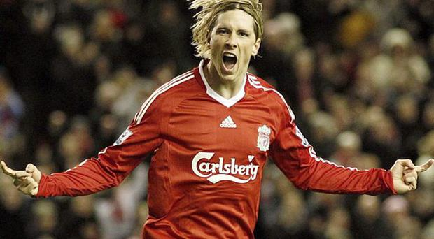 Liverpool's Fernando Torres celebrates scoring their fourth and his second goal of the game during the Barclays Premier League match at Anfield, Liverpool.