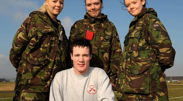 DATE: 18 February 2010LOCATION: BallykinlerUNIT: Regimental Recruiting TeamJOB NUMBER: DPO-008-2010PHOTOGRAPHER: Mike O'NeillCAPTION: Army Look At Life in BallykinlerIn this image: Glenda Gowdy, 18 from Newtownards Technical College poses with Army Physical Training Instructor Lance Corporal Will Galloway along with Natalie Galbraith, 17 and Chelsea Hamilton, 17, who go to Girls Model.Last week whilst most young people were enjoying half term, a hardy group of school and college pupils took on what the Army had to offer at a 'Look at Life' week in Ballykinler. The students were put through their paces in a number of different situations including physical fitness, command tasks and other military lessons.The week is designed so that young people can try and taste what the Army may have to offer.Image by Mike O'Neill.Please Credit Photographer.FOR MORE INFORMATION PLEASE CONTACT:Defence Press OfficeHQNI BFPO 825Tel: Civ: 02892 263419Mil: 9491 63419