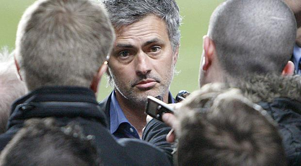 Jose Mourinho speaks to reporters at Stamford Bridge last night after his Inter Milan side knocked Chelsea out of the Champions League