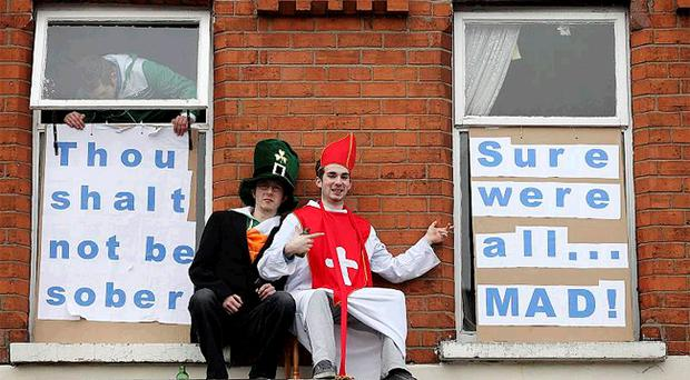 Students in the Holy Land area of Belfast celebrating St Patrick's Day yesterday