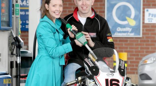 North West 200 regular John Burrows and Bronagh Henderson, Marketing Manager Henderson Group, take full advantage of the Belfast Telegraph's upcoming fuel promotion