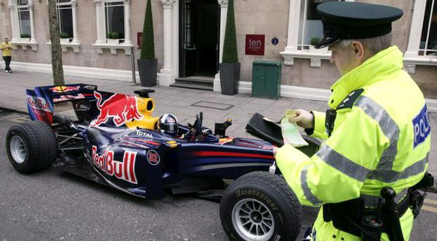 David Coulthard may be a Formula One ace, but he'll still get a parking ticket if he leaves his car on double yellow lines