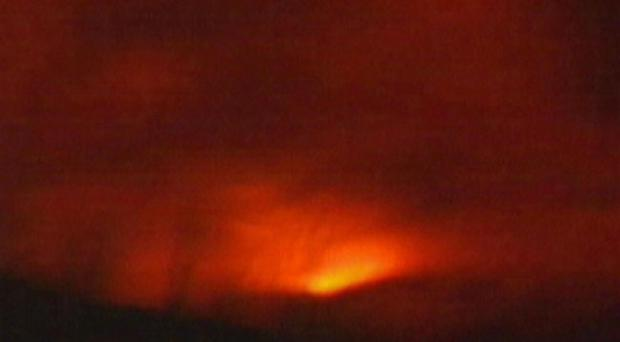 This frame grab from APTN shows the volcano near the Eyjafjallajoekull glacier, the fifth largest glacier in Iceland, as it begins erupting early Sunday morning March 21, 2010. Fearing flooding from the glacier melt, authorities evacuated some 400 people in the area 160 kilometers (100 miles) southeast of the capital, Reykjavik, as a precaution but no damage or injuries have been reported according to authorities. The last time the volcano erupted was in the 1820s. (AP Photo/APTN)