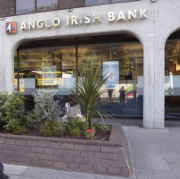 Former Anglo Irish Bank executive William McAteer and three co-accused will stand trial in 2016 on charges of conspiring to mislead the bank's investors about the true value of its deposit books