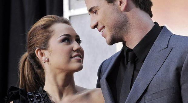 Liam Hemsworth said it was hard not to get close to Miley Cyrus