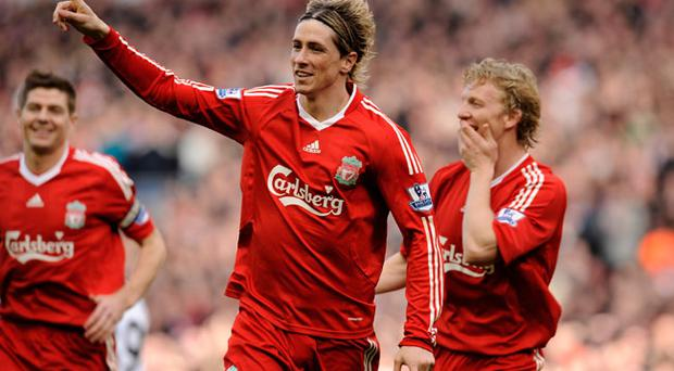 LIVERPOOL, ENGLAND - MARCH 28: Fernando Torres of Liverpool celebrates scoring the opening goal during the Barclays Premier League match between Liverpool and Sunderland at Anfield on March 28, 2010 in Liverpool, England.