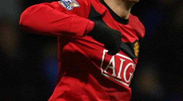 Manchester United's Dimitar Berbatov celebrates scoring their second goal during the Barclays Premier League match at the Reebok Stadium, Bolton