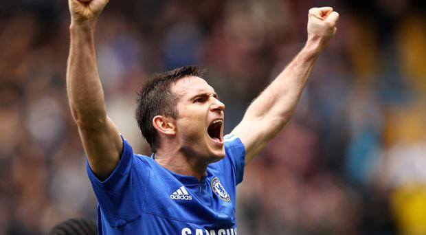 Frank Lampard of Chelsea celebrates scoring his second goal during the Barclays Premier League match between Chelsea and Aston Villa at Stamford Bridge on March 27, 2010 in London, England