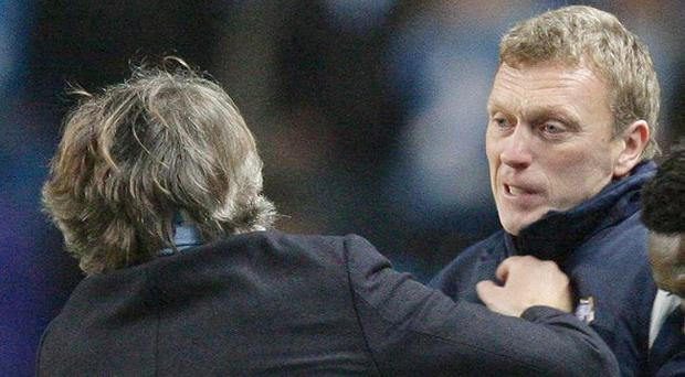 <b>Roberto Mancini v David Moyes</b><br/> The spat between the two managers occurred in the late stages of the match at Eastlands. With City trailing 2-0, their Italian manager was eager to get things moving, so when his counterpart held on to the ball a little longer than he should have done, Mancini was incensed. The City manager lurched at Moyes to retrieve it, leading to a fierce exchange of words and red cards for the pair of them.