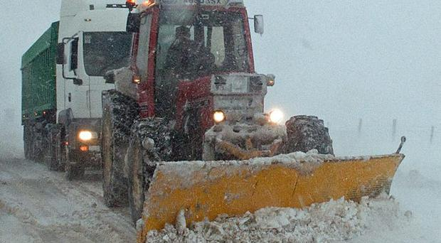 A snowplough tows a lorry on the Glenshane Pass. 30.3.10