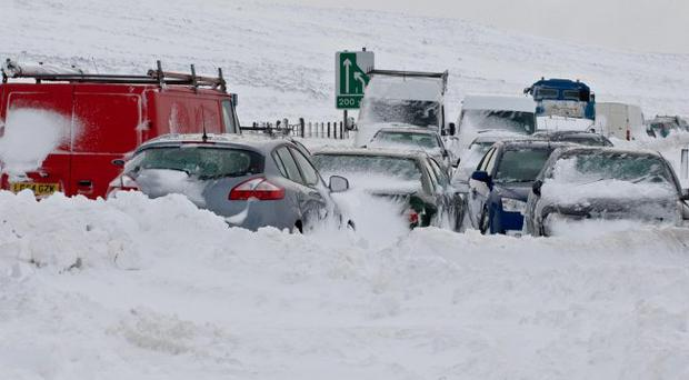 Cars abandoned on the Glenshane Pass this morning. Picture Martin McKeown. 31.3.10