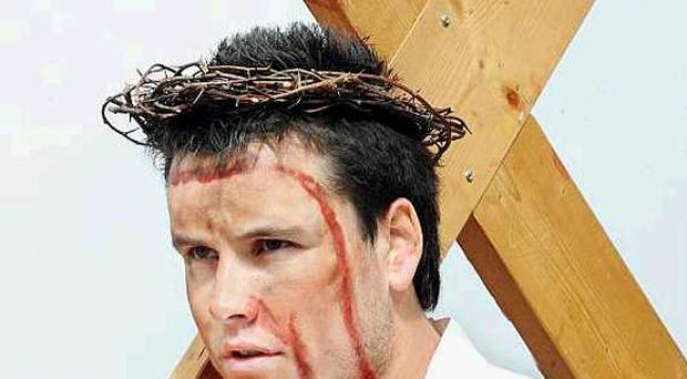 Michael O'Hare, as Jesus, during the re-enactment of the trial and crucifixion of Christ by pupils at St Genevieve's and St Louis House in west Belfast