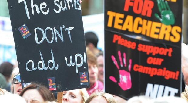 Teachers threaten strike action over public sector pay cuts