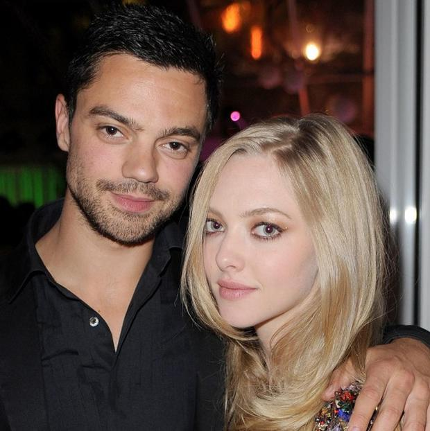 Amanda Seyfried has admitted to checking boyfriend Dominic Cooper's mobile