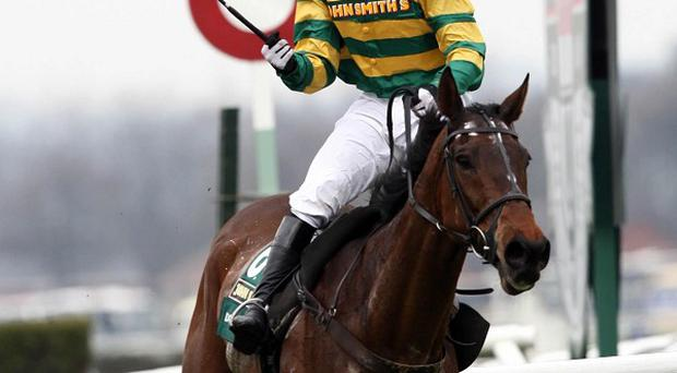 Jockey Tony McCoy on Don?t Push It romped to his first victory in the Grant National
