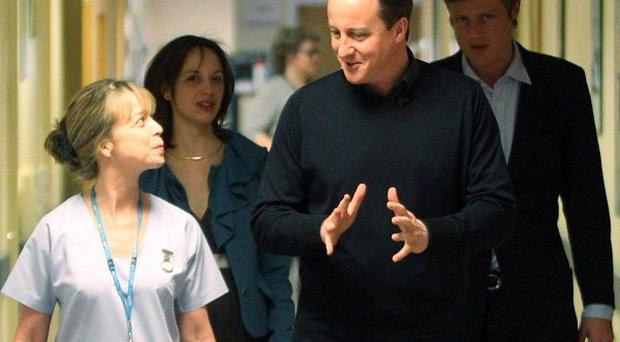 Conservative Party Leader David Cameron visits Kingston Hospital in Surrey