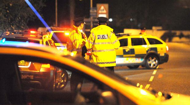 Police at the scene of the bomb attack near Palace Barracks in Holywood, Co Down