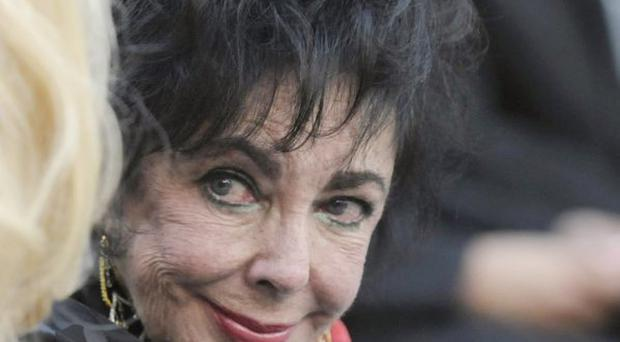 Elizabeth Taylor attends Michael Jackson's funeral service held at Glendale Forest Lawn Memorial Park on Sept. 3, 2009