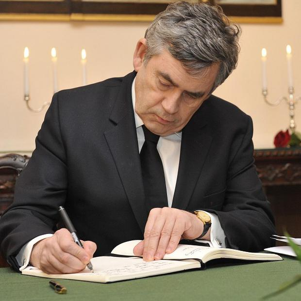 Gordon Brown joined mourners at the Polish embassy in London
