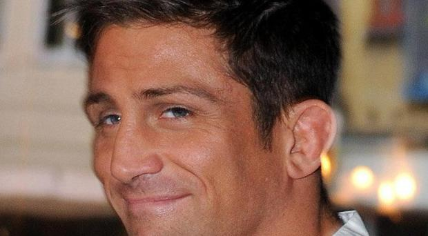 Alex Reid has been forced to postpone a fight - after injuring himself during a TV show