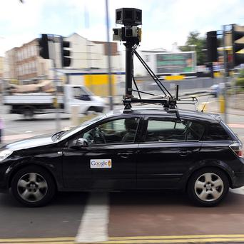 A Google mapping car with video and photography equipment mounted on top