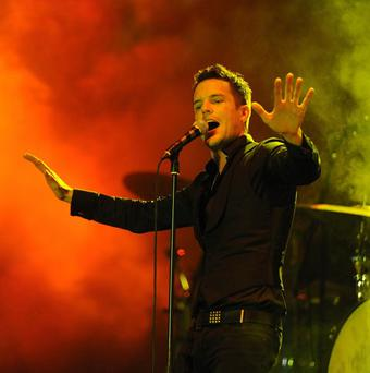 Brandon Flowers of The Killers takes to the stage