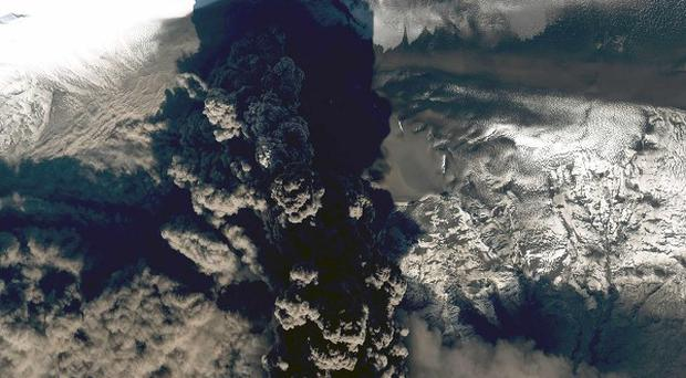 A GeoEye image shows a smoky plume of volcanic ash rising from the Eyjafjallajokull volcano in Iceland.