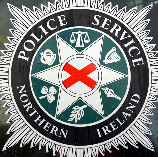 Three people were injured after a bomb exploded outside a police station in Armagh