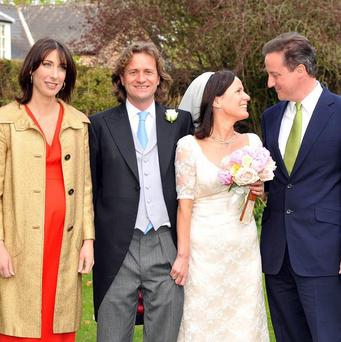David Cameron (right) at the wedding of his younger sister Clare (second right)