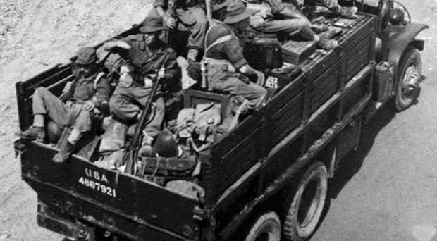 A lorry full of British troops moves toward a front-line in South Korea. A memorial to Northern Irish troops who served in the conflict has been dedicated in Belfast