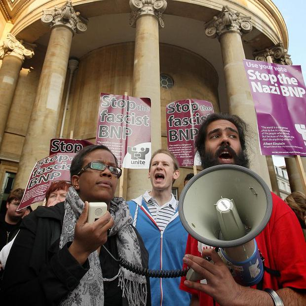Members of Unite Against Fascism demonstrate near BBC Broadcasting House against the screening of a BNP broadcast