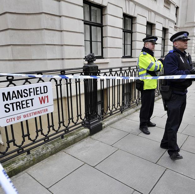 Police outside a mansion block in Mansfield Road, close to Oxford Street, where bomb suspect Umar Farouk Abdulmutallab had been living