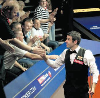 On a roll: Ronnie O'Sullivan surged into the World Championship quarter-finals with a superb 13-10 win over Mark Williams