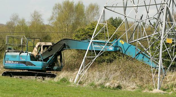 The scene at Kilbride, Clara, Co. Offaly after a stolen digger collided with an pylon in the middle of a field.