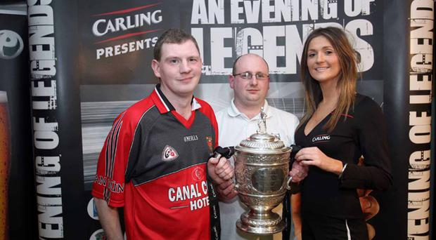 Newry fans Jonny Ferns and David Larkin with Carling's Trish Hanna at the 'Carling Presents an Evening of Newry Legends' event