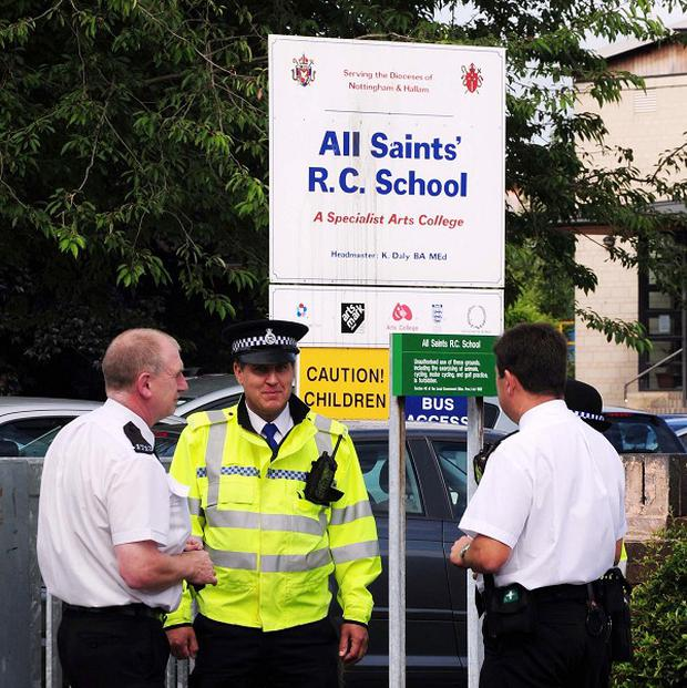 Police officers outside All Saints' Roman Catholic School in Mansfield