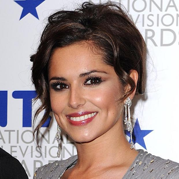X Factor judge and Girls Aloud star Cheryl Cole is the first Briton to top the FHM's 100 Sexiest Women in the World poll
