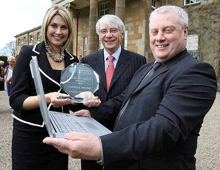 BBC's Sarah Travers and the Department for Employment and Learning's Permanent Secretary Alan Shannon with Alastair McCormick as they celebrate Alan's success on being crowned Essential Skills Learner of the Year for 2010