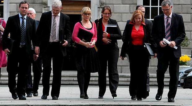 Workers outside the Dail, Dublin, including Quinn Insurance spokesperson Mona Birmingham (2nd right), who vowed to fight plans to make around 800 staff redundant