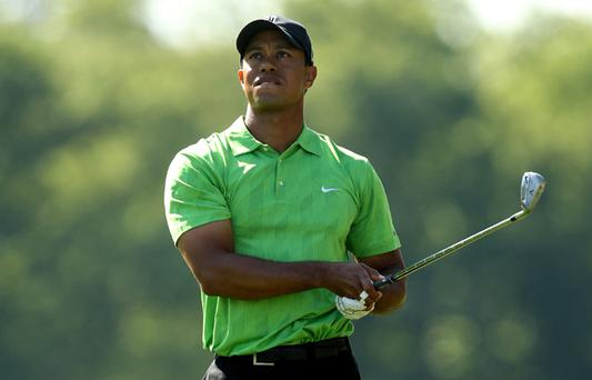 Tiger Woods watches his shot on the 18th hole during the first round of the Quail Hollow Championship at Quail Hollow Country Club on April 29, 2010 in Charlotte, North Carolina