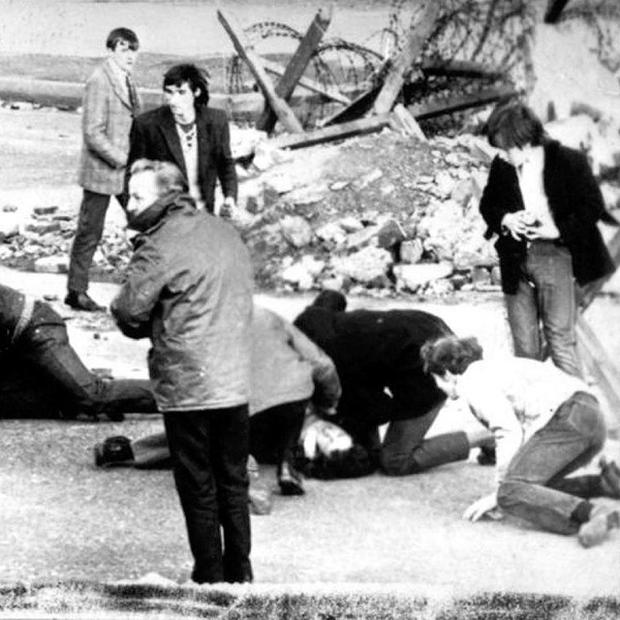 An injured man receives treatment on Bloody Sunday. Survivor and campaigner Johnny Duddy has died aged 87