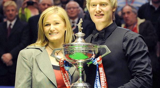 Neil Robertson with his mother Alison Hunter and the trophy after winning during the Final of the Betfred.com World Snooker Championships at the Crucible Theatre, Sheffield