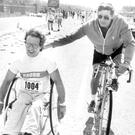The only wheelchair competitor, John Walls, from Belfast, gets some encouragement from a supporter. 8/5/1984