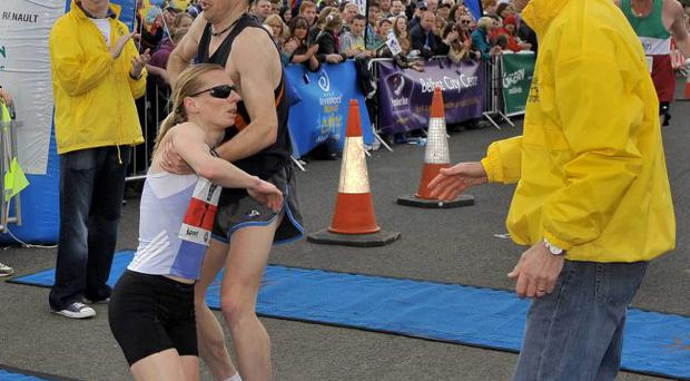 ©Russell Pritchard / Presseye 3rd May 2010Deep RiverRock Belfast Marathon 20102nd woman Maria McCambridge, who collapsed in her husbands arms, Gaqry Crossan©Russell Pritchard / Presseye